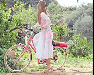 Amberleigh West on a Bike in the Garden