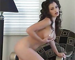 Aria Giovanni teasing and showing off her big milk jugs on the coach